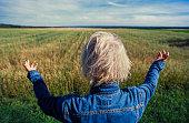 Woman overlooking farmland.