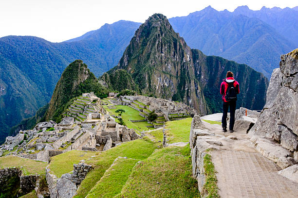 woman overlooking the inca ruins of machu picchu - south america travel stock photos and pictures