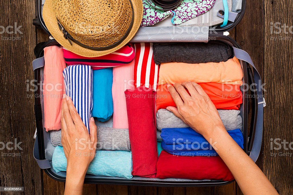 woman packing a luggage for a new journey royalty-free stock photo