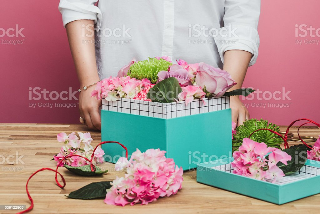 Woman packing flowers gift stock photo