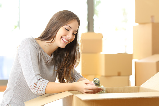 istock Woman packing or unpacking moving home 535497484