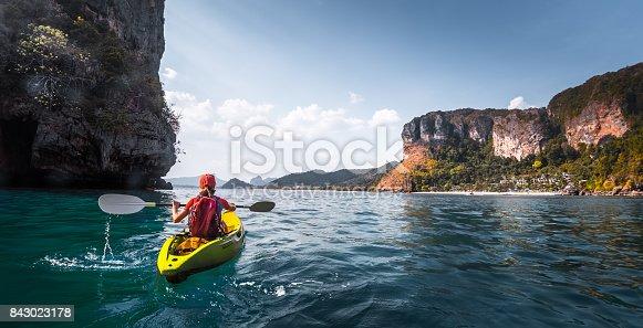 516449022 istock photo Woman paddles kayak 843023178