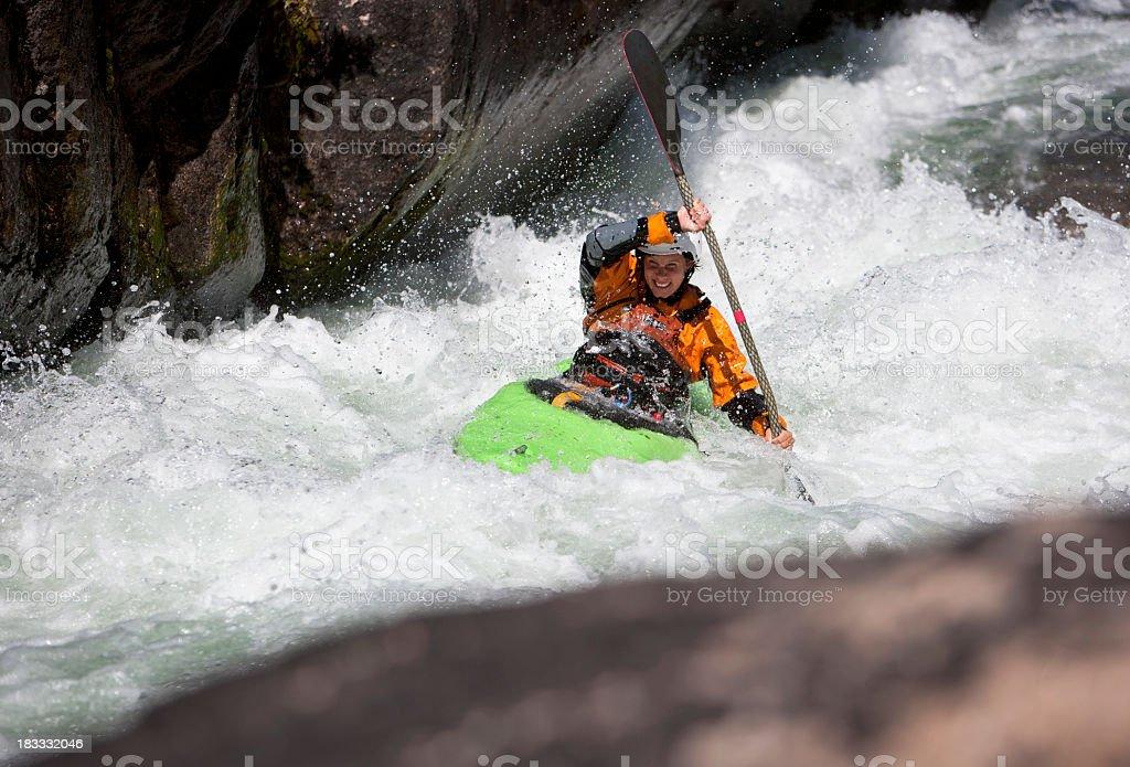 Woman Paddling a White Water Kayak on a Montana River stock photo