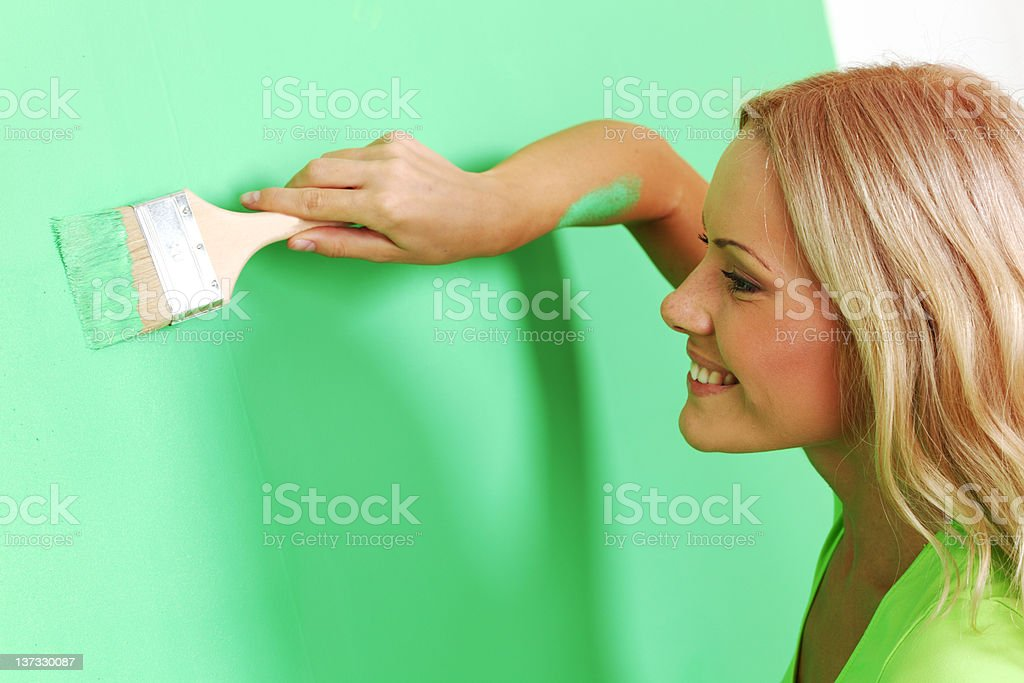 woman paint on wall royalty-free stock photo