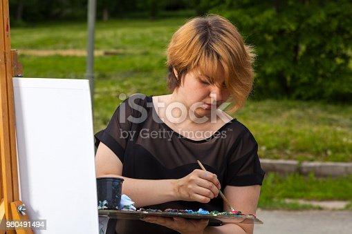 istock Woman paint 980491494