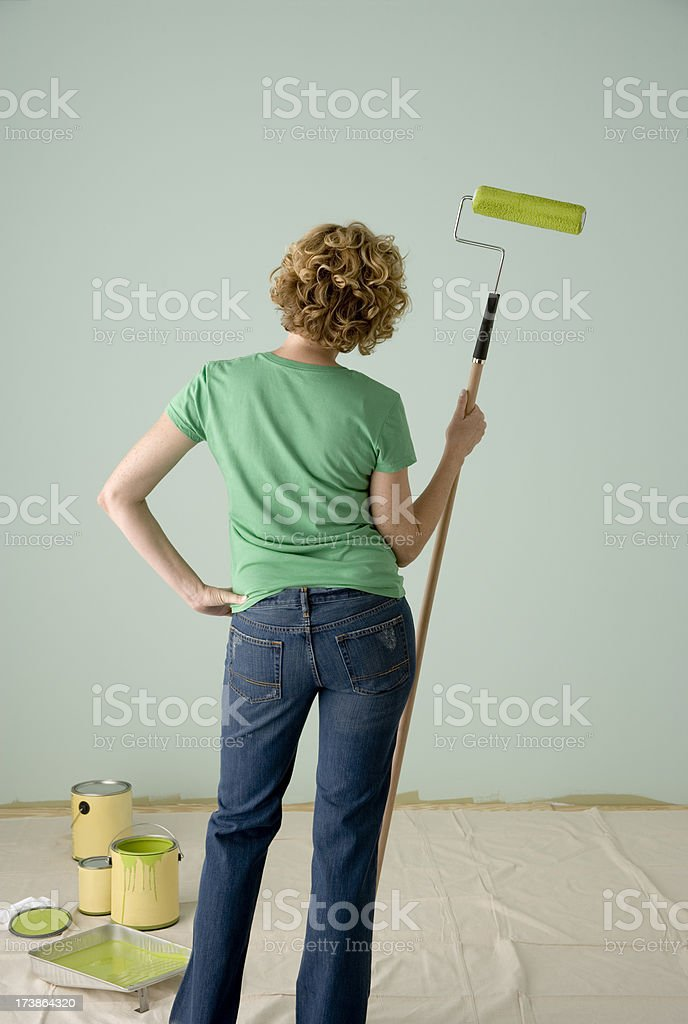 Woman Painting a Green Wall royalty-free stock photo