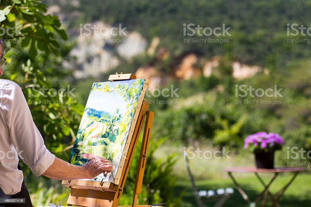 Woman painting at an easel stock photo