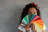 istock Woman painting her house and holding a color palette 1188217403