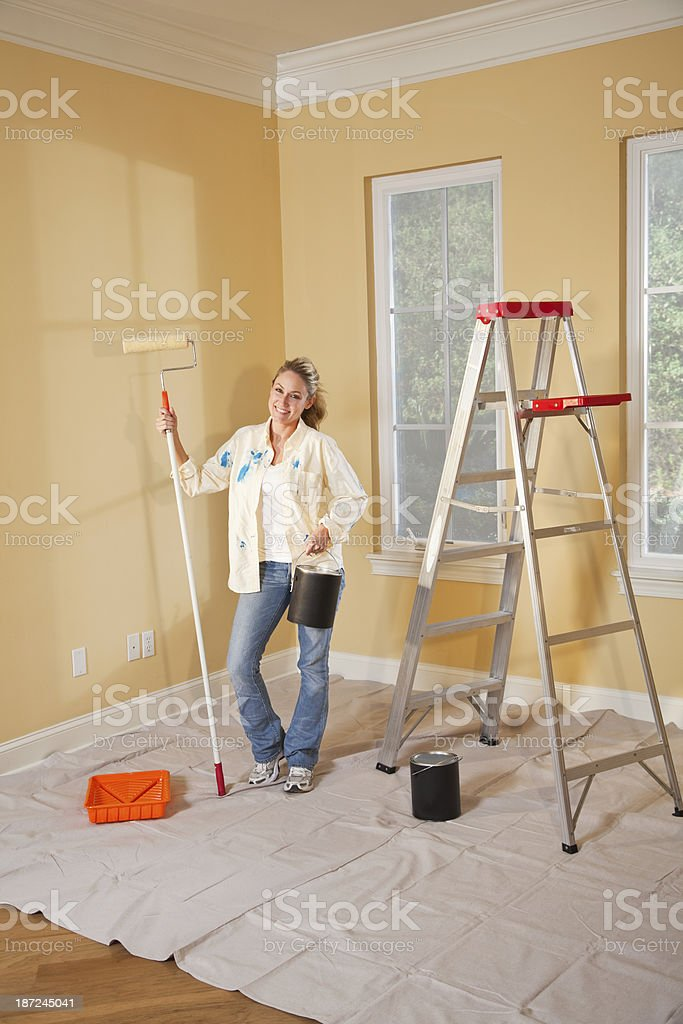 Woman painting home interior stock photo