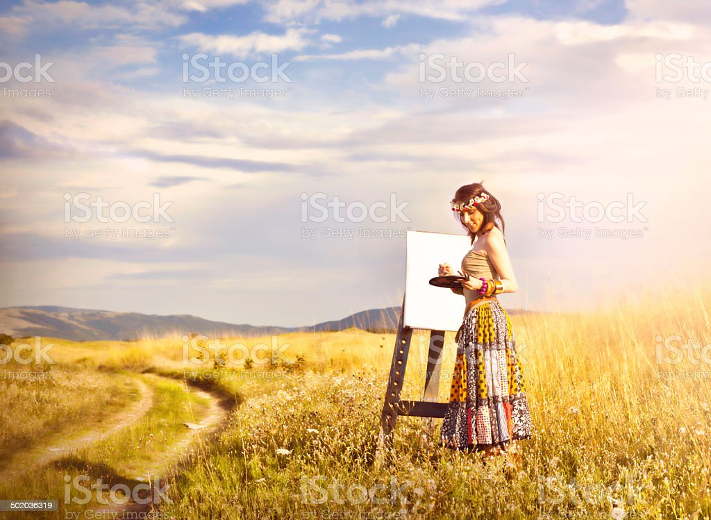 Woman Painting In Field royalty-free stock photo