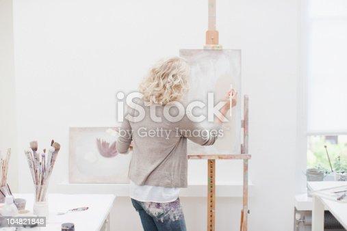 istock Woman painting on canvas in art studio 104821848