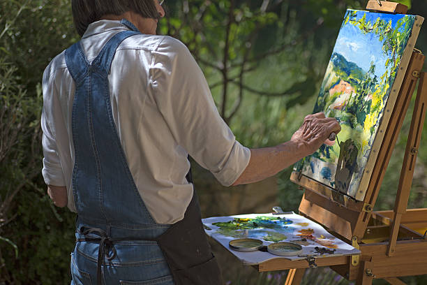Woman painting en plein air stock photo