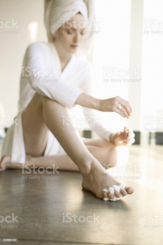 Woman painting toenails royalty free stockfoto