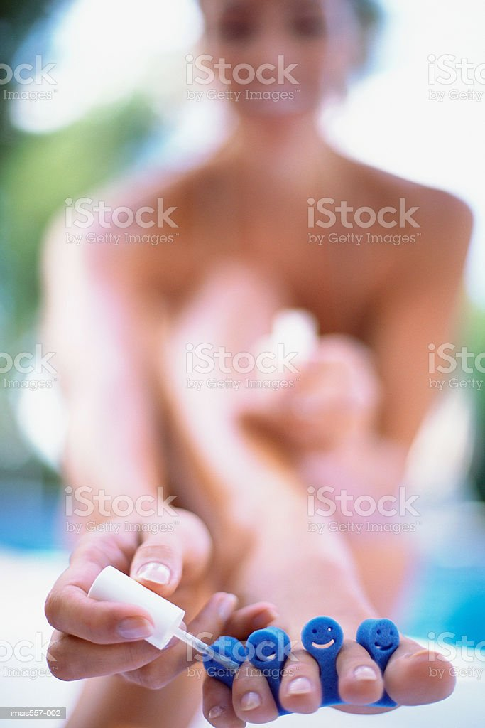 Woman painting toenails royalty-free stock photo