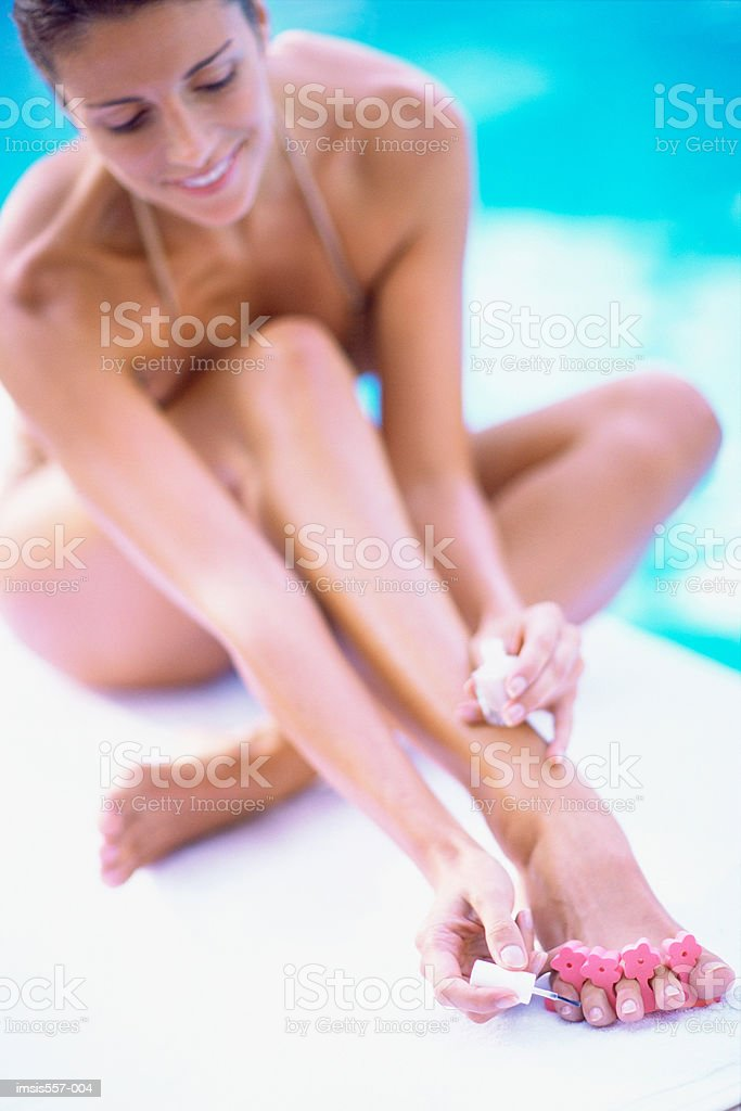 Woman painting toenails royalty-free 스톡 사진