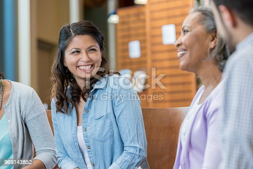 956725740istockphoto Woman participates in group therapy session 969143852