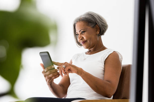 Woman participates in video call with family stock photo