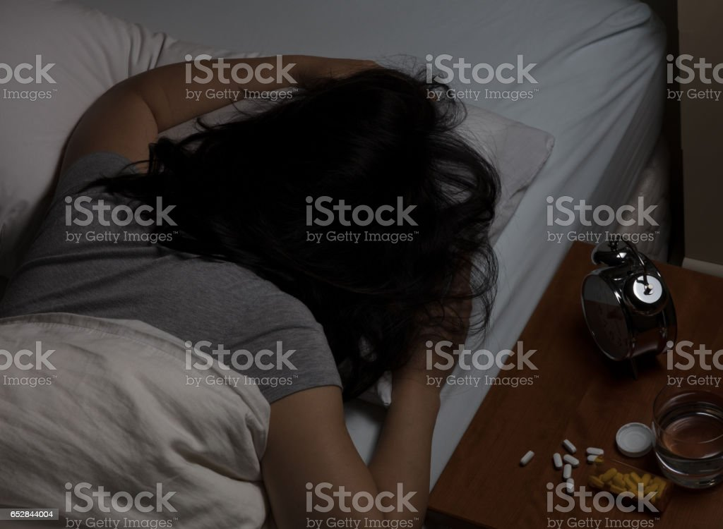 Woman passed out from taking pain medicine stock photo
