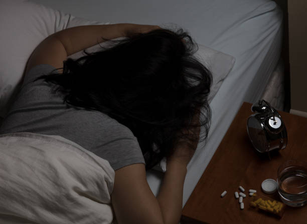 Woman passed out from taking pain medicine - foto stock