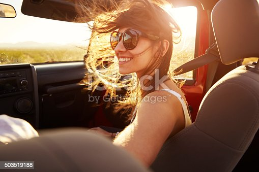 istock Woman Passenger On Road Trip In Convertible Car 503519188