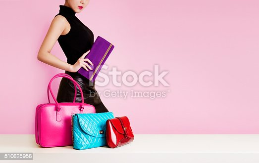 istock Woman passing by many colorful bags. Shopping. Fashion image. 510625956