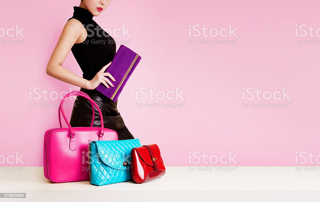Woman passing by many colorful bags. Shopping. Fashion image. stock photo