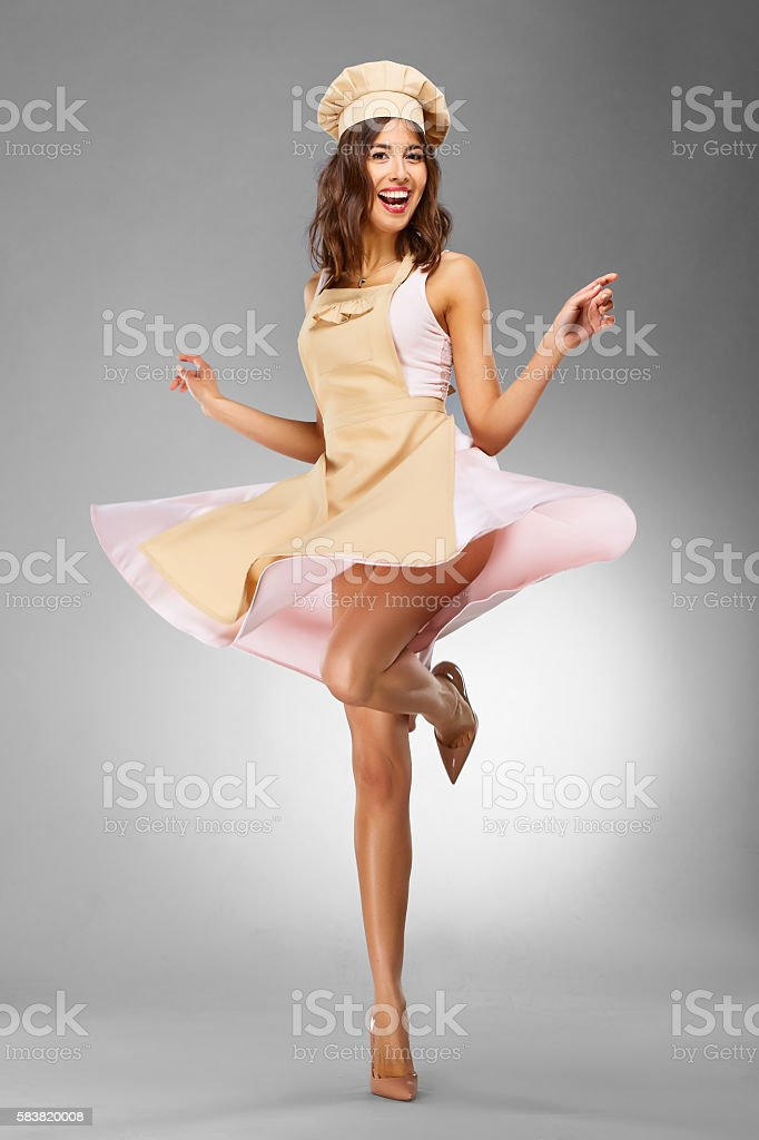 Woman Pastry Chef Holding Huge Cupcake stock photo