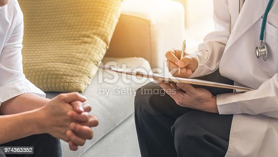 964904920 istock photo Woman patient having consultation with doctor (gynecologist or psychiatrist) and examining  health in medical gynecological clinic or hospital mental health service center 974363352