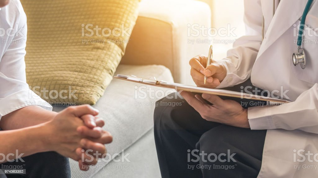 Woman patient having consultation with doctor (gynecologist or psychiatrist) and examining  health in medical gynecological clinic or hospital mental health service center stock photo