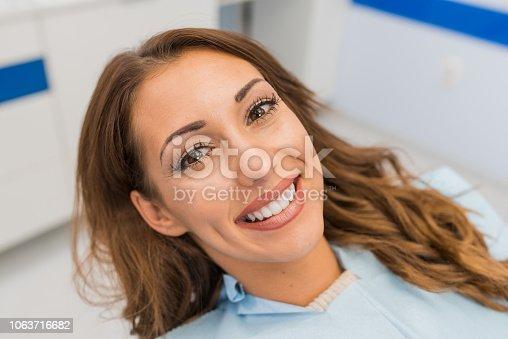 Beautiful young woman smiling and looking at camera