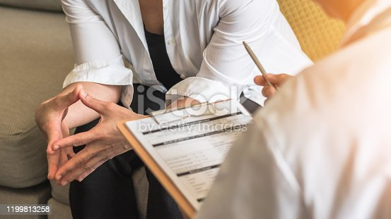 964904920 istock photo Woman patient with doctor or psychiatrist consulting and diagnostic examining on obstetric - gynecological female illness, or mental health in medical clinic or hospital healthcare service center 1199813258