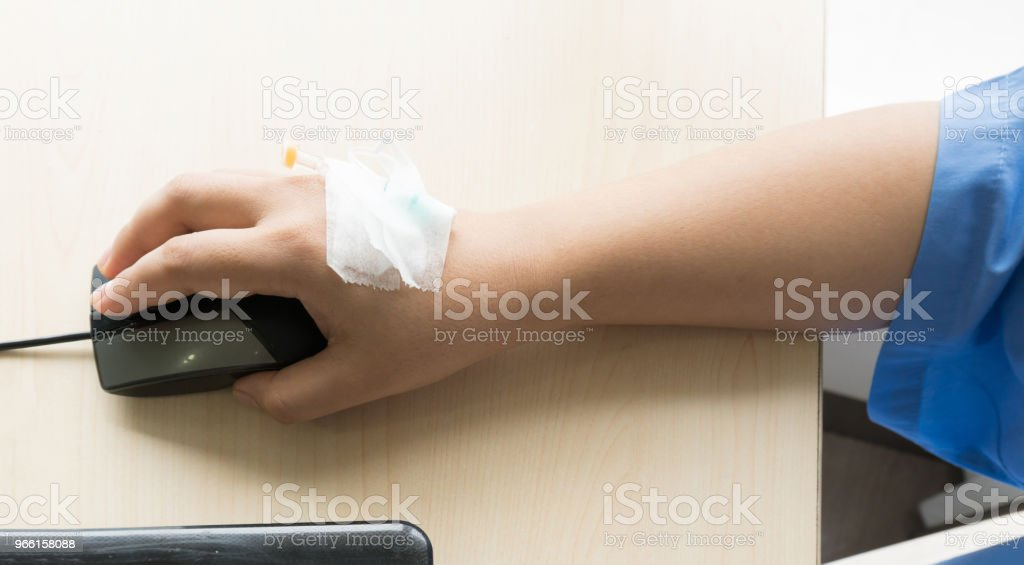 Woman patients on the bed have injection saline and working during in hospital - Royalty-free Adult Stock Photo