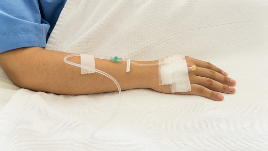 Woman Patients On The Bed Have Injection Saline Stock Photo - Download Image Now