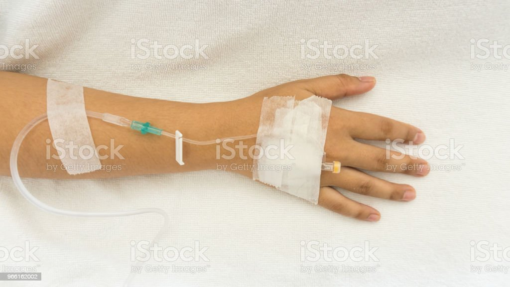 Woman patients on the bed have injection saline - Royalty-free Arm Stock Photo