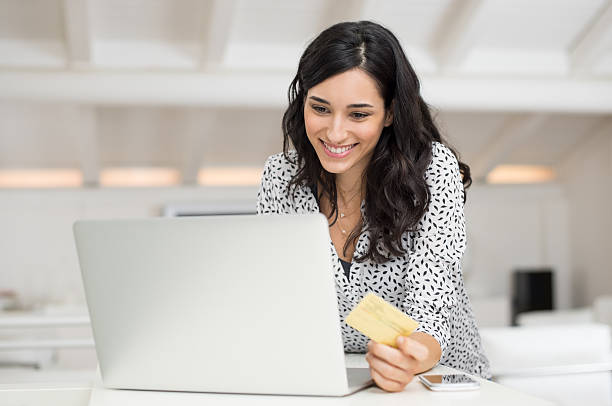 Woman paying bill online stock photo