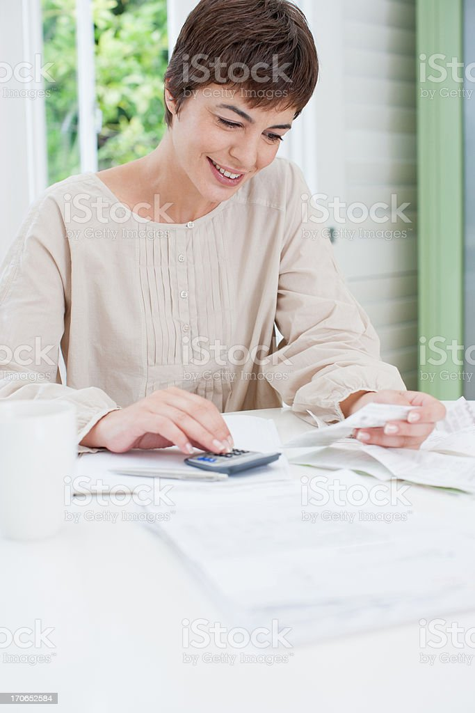 Woman paying bills on smile royalty-free stock photo