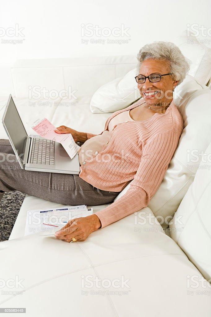 Woman Paying Bills Online stock photo
