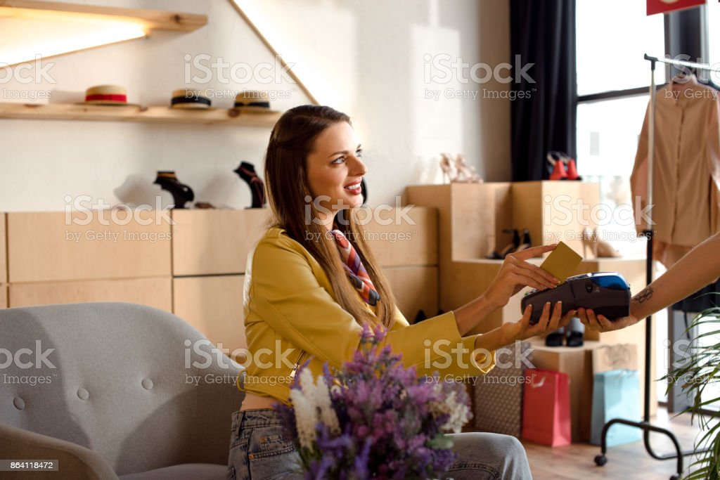 woman paying by credit card and terminal royalty-free stock photo