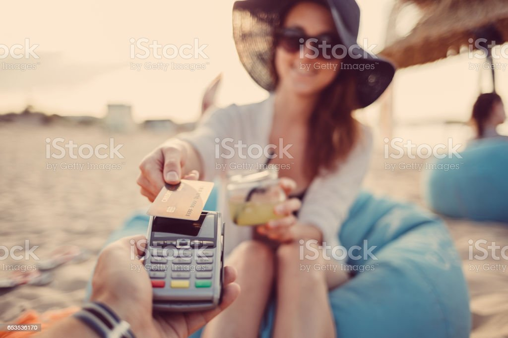 Woman paying contactless with credit card stock photo
