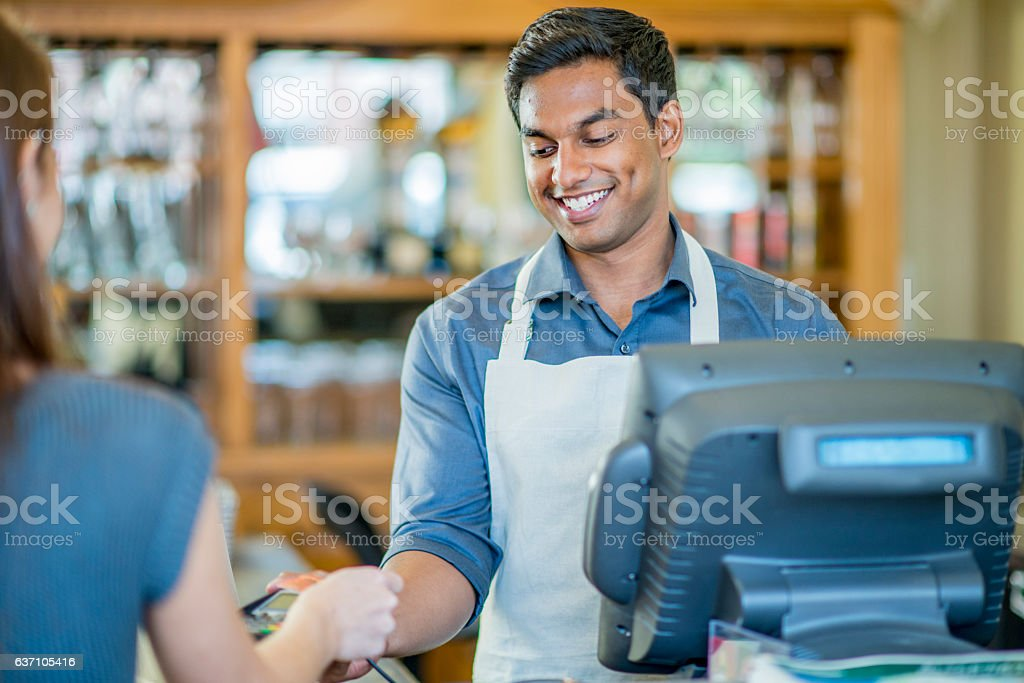 Woman Paying for a Meal at a Local Cafe stock photo