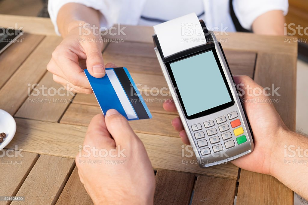 woman paying for coffee by credit card stock photo