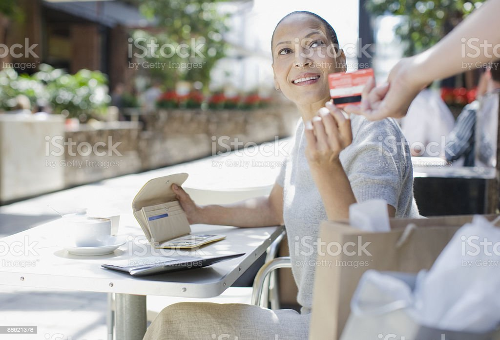 Woman paying for coffee with credit card royalty-free stock photo