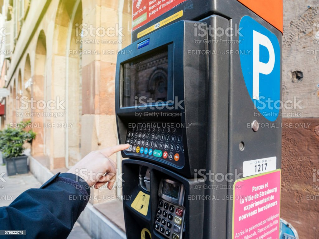 Woman paying for parking at the new Parking ticket payment machine - foto de acervo