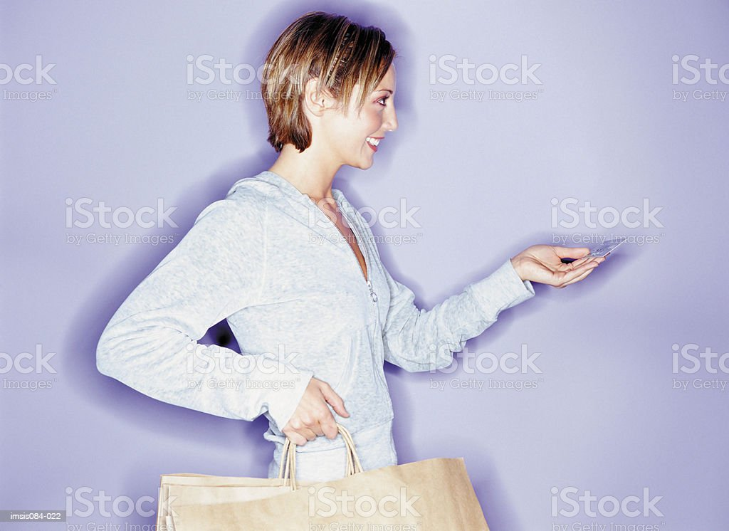 Woman paying with credit card royalty-free stock photo