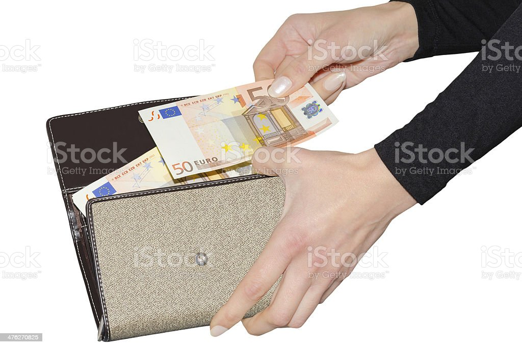Woman paying with euro from her purse royalty-free stock photo