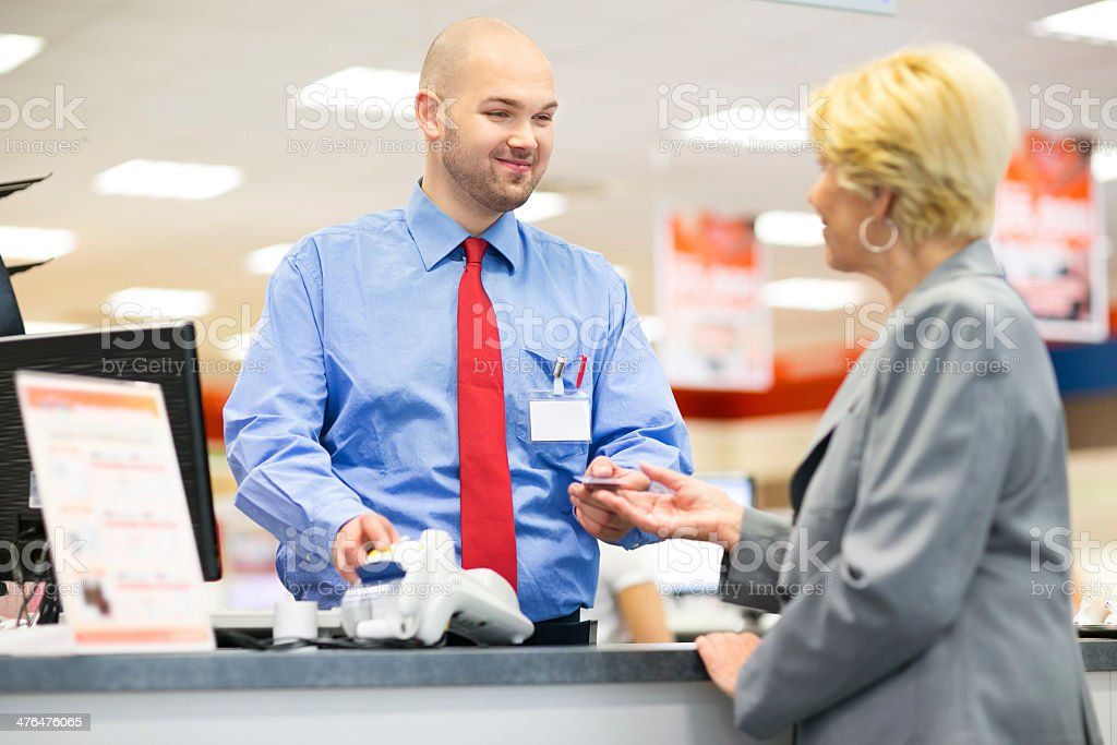 Woman paying with her card royalty-free stock photo