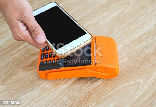 istock Woman paying with smartphone 971289290