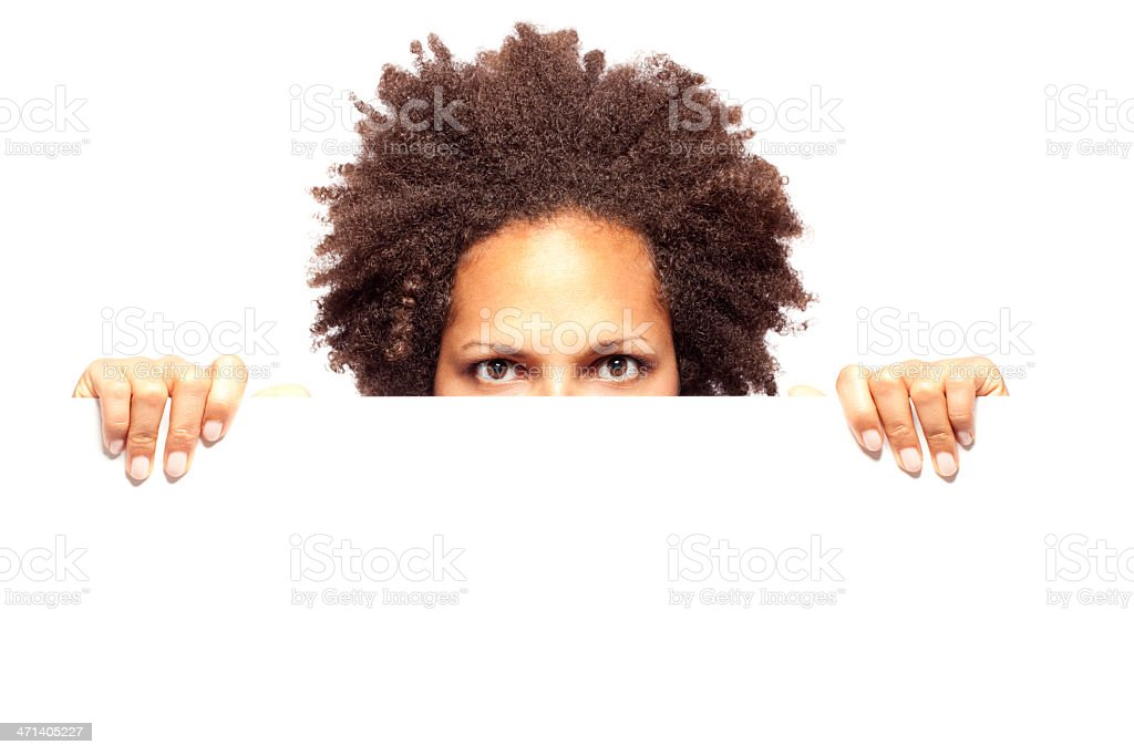 Woman peeking behind blank sheet royalty-free stock photo
