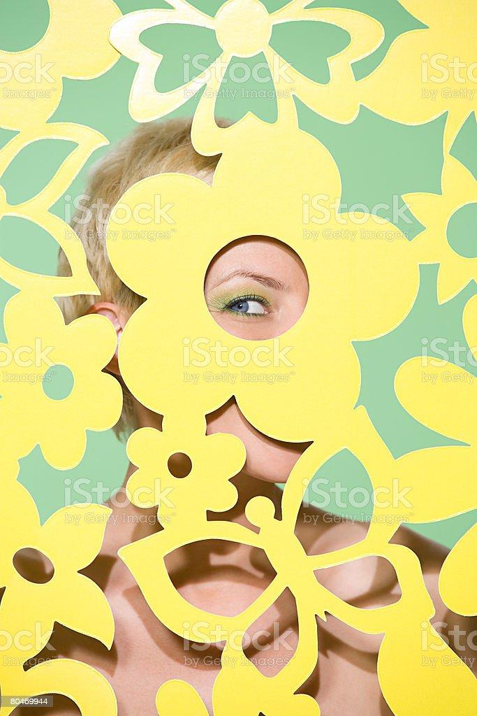 Woman peeking through cutout Lizenzfreies stock-foto