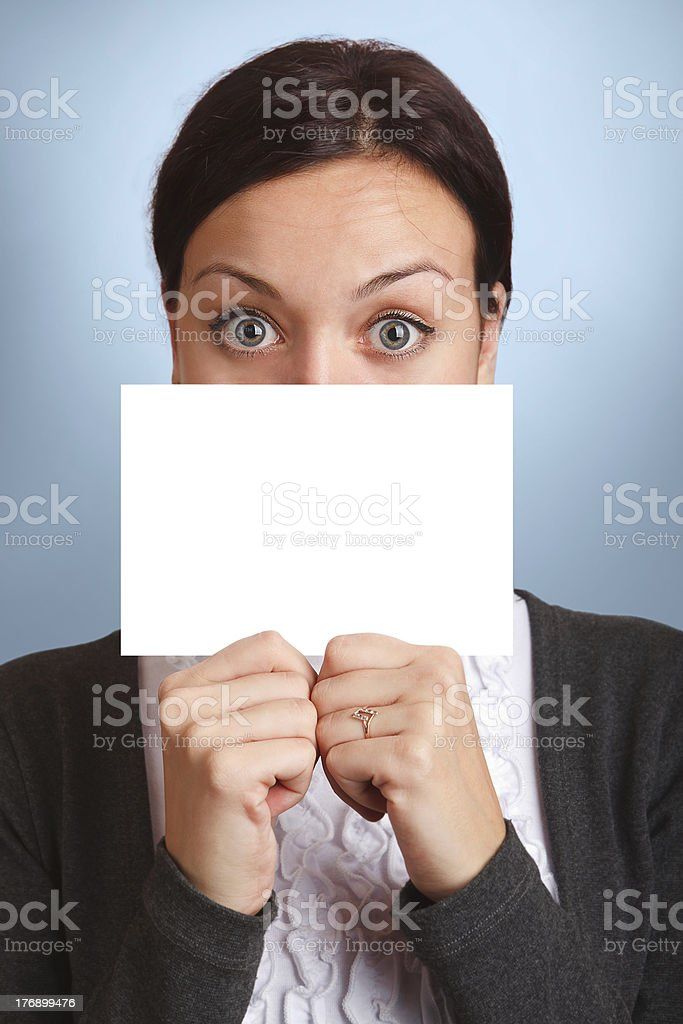 woman peering over  blank sign or card royalty-free stock photo